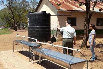 International Development Charity assess water tanks